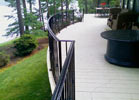The custom radius on this iron railing makes a statement on this deck.
