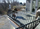Bowed metal pickets do very well on balconies.