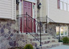 Look at the beauty these metal railings add to the stone stairs.