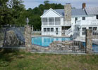This decorative wrought iron fence adds a long lasting beauty to this swimming pool.