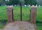 This wrought iron fence makes a great entrance to the cemetary.